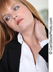 Closeup of a businesswoman with neckache