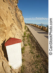 White milestone - Milestone with copy space next to a scenic...