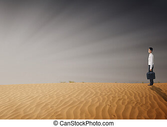 asian businessman in the middle of desert crisis concept...
