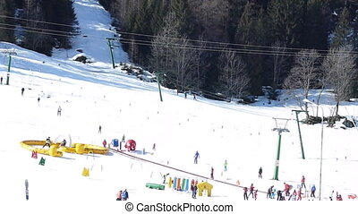 winter sports on Alps - People Skiing on fresh snow in...