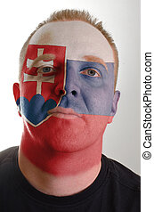 Face of serious patriot man painted in colors of slovakia...
