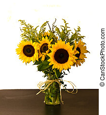 Colorful arrangement of sunflowers in vase - A colorful...