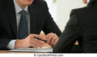 Vacant position - Young man interviewing a candidate for...