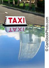 Taxi & Skyscraper Reflection, Hong Kong - Close-up of Hong...