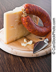 Parmesan cheese piece with spicy sausage