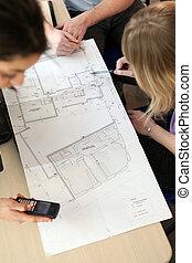 Group designing real estate plan