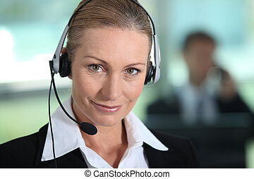 Woman smiling with headset