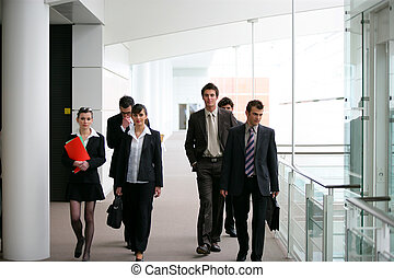 Businesspeople walking in a hallway