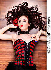 corset - Portrait of a sexy beautiful woman posing at studio...