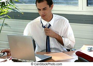 Stressed office worker loosening his tie