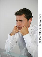 business man sighing