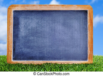 blank blackboard on the grass - a blank blackboard on the...