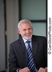 Cheerful gray-haired businessman