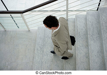 Businessman walking down some stairs