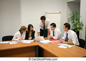 Businesspeople having a meeting in a boardroom