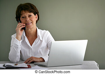 Middle-aged office worker at her desk