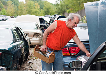 Backyard Mechanic Junk Yard Shopping - A man browses for car...