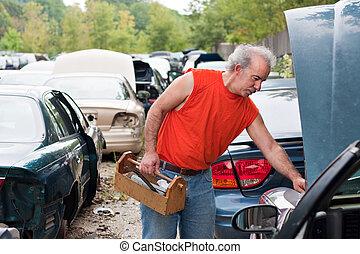 Backyard Mechanic Junk Yard Shopping - A man browses for car...