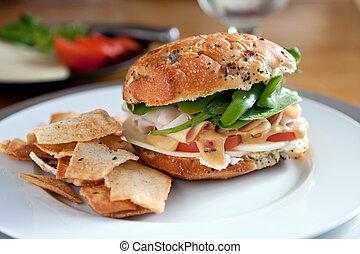 Deli Sandwich on an Onion Roll - Large turkey sandwich with...