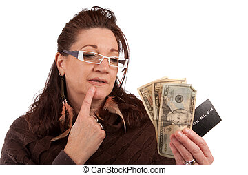 Should I Use Cash or Credit Card - Middle aged woman...