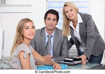 Three colleagues in office