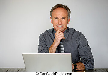 Businessman using a laptop computer