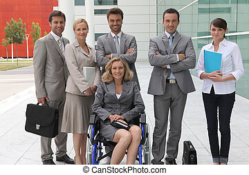 woman in wheelchair with colleagues