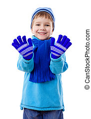 Smiling boy in winter clothes