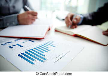 Charts - Image of document with charts on background of male...