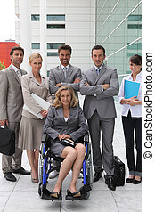 woman in a wheelchair and team