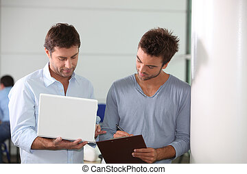 Colleagues looking at a laptop computer