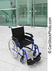 Empty wheelchair outside office building