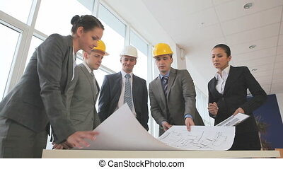 Business drafting - Three businessmen or engineers in...