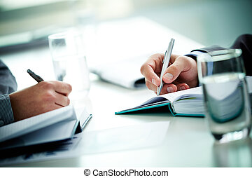 Teamwork - Image of male and female hands with pens over...