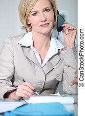 Woman holding headset
