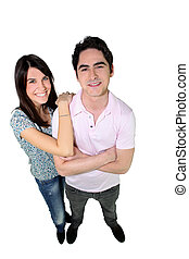 Studio full length shot of a young couple in love