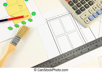 Architect desktop with calculator.