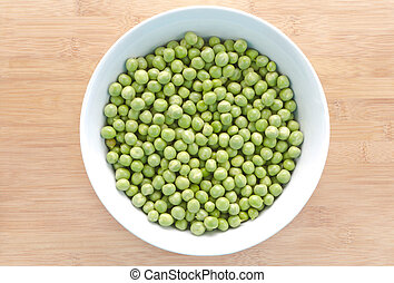 Pea seeds in bowl with chopping board