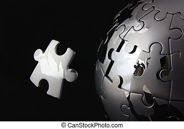 Floating jigsaw over globe - Floating jigsaw peiceover...