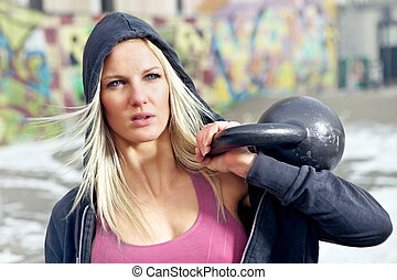 Portrait fitness woman with weight - Young determined...