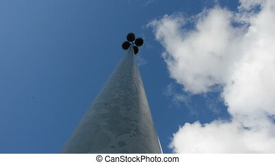 street lamp metal stake and sky clouds