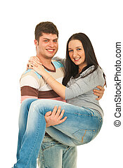 Happy guy holding woman in his arms isolated on white...
