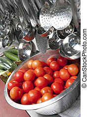 tomatoes in a stainless steel colander
