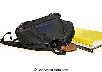 School bookbag and pistol - A 38 caliber pistol sticks out...