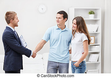 Consultant at home - The consultant shakes hands with a man
