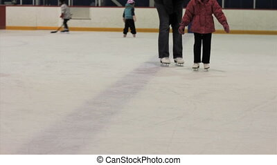 Little Girl Skating On Ice - A cute little 5 year old Asian...