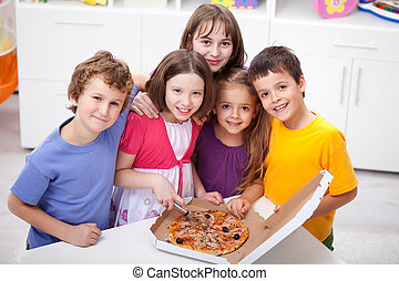 Kids at home with pizza