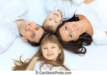 Happy family, mother, father and daughter resting on the...