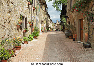 street paved with brick in old italian borgo Sovana in...