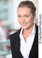 Closeup of a smiling successful businesswoman